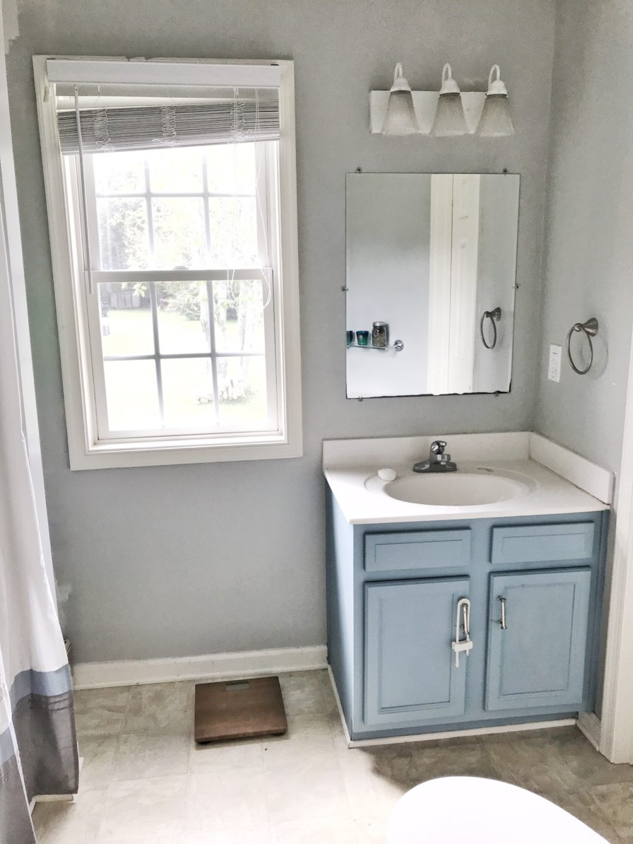 Modern Navy and White Bathroom Renovation including DIY painted vanity, painted vinyl floors and mixed metals from StampinFool.com