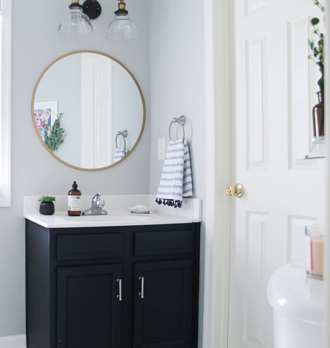 DIY steps for powder room project in this navy and gold bathroom