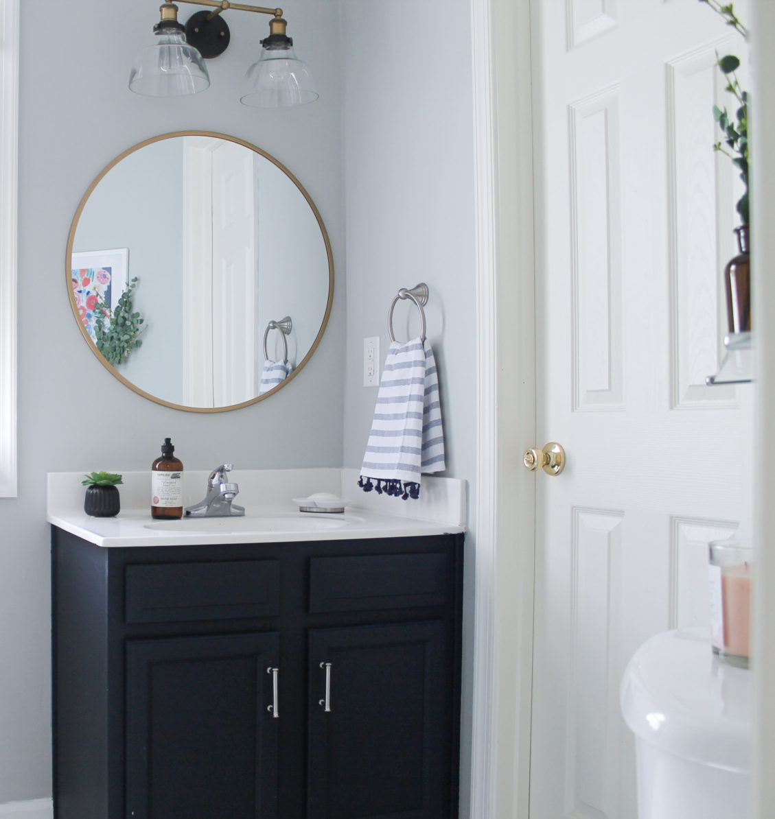 Modern Navy and White Bathroom Renovation including DIY painted vanity, painted vinyl floors and mixed metals