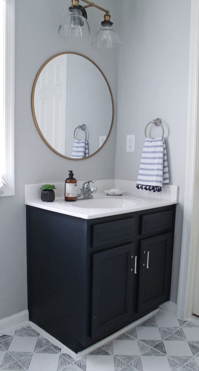 One Room Challenge: Guest Bath Reveal in Williamsburg, VA from StampinFool.com Modern Navy and White Bathroom Renovation including DIY painted vanity, painted vinyl floors and mixed metals from StampinFool.com