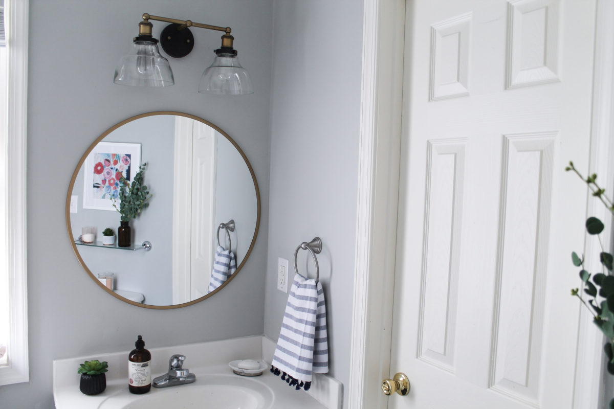 One Room Challenge: Guest Bath Reveal in Williamsburg, VA. Modern Navy and White Bathroom Renovation including DIY painted vanity, painted vinyl floors and mixed metals from StampinFool.com