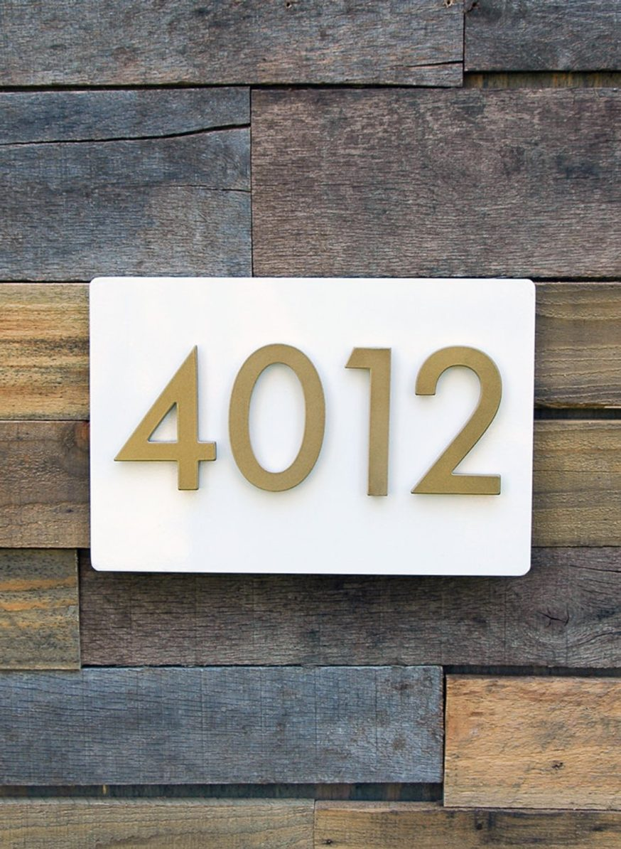 white plate with gold modern house numbers