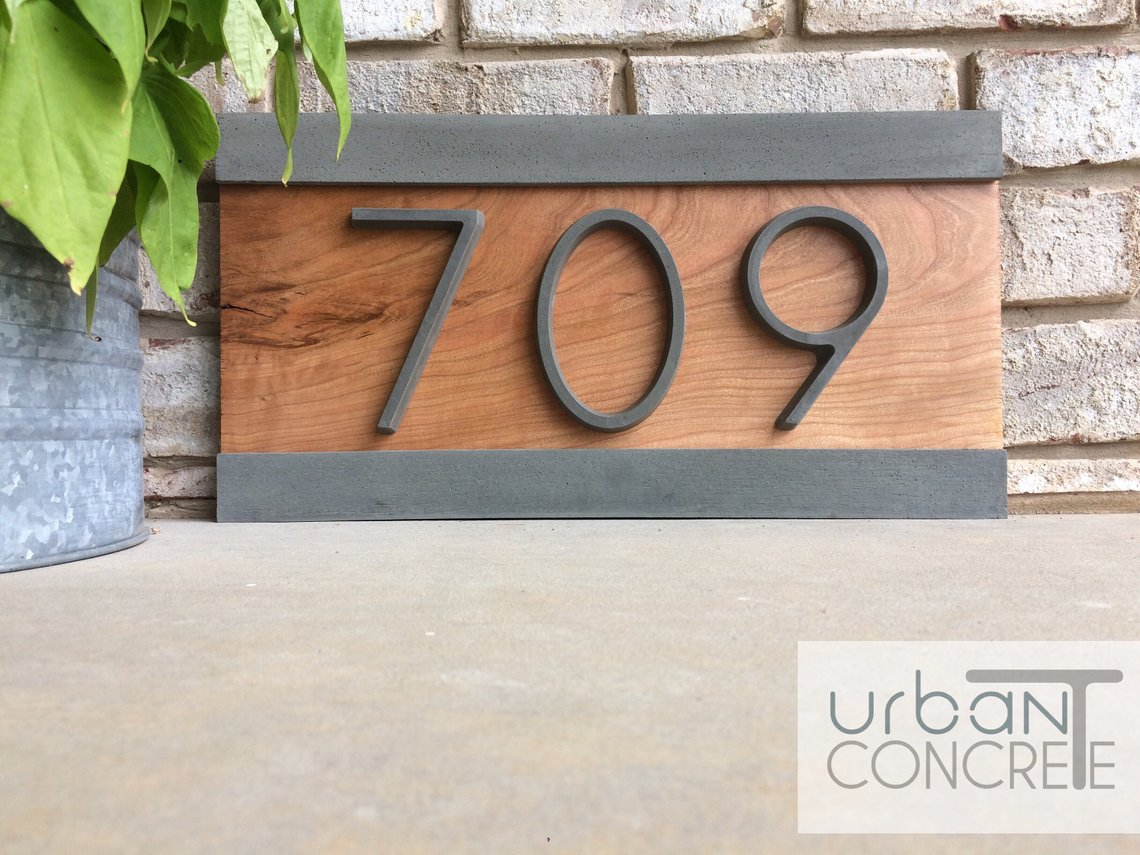 wood and concrete address plate with house number 709