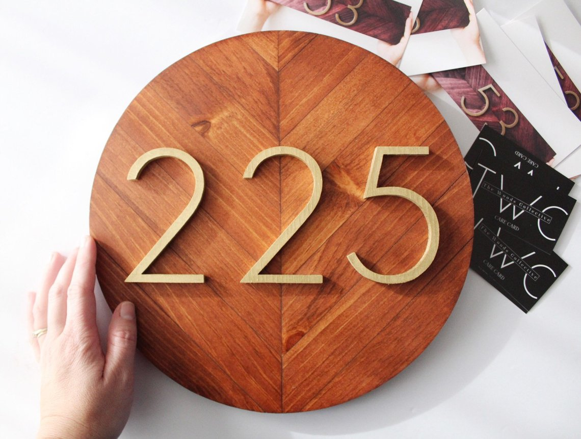 Round wooden house number plaque with gold 225
