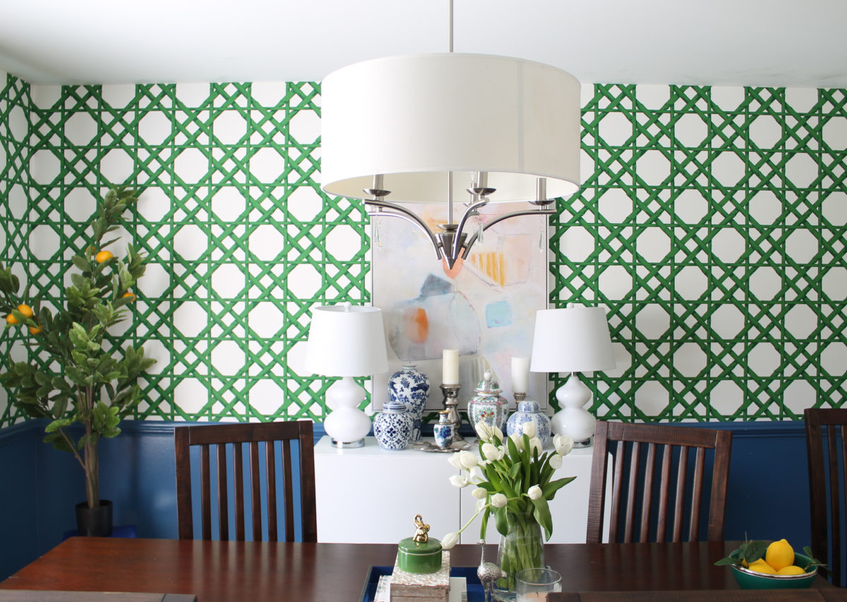 Blue and green dining room with green cane wallpaper and ginger jar collection