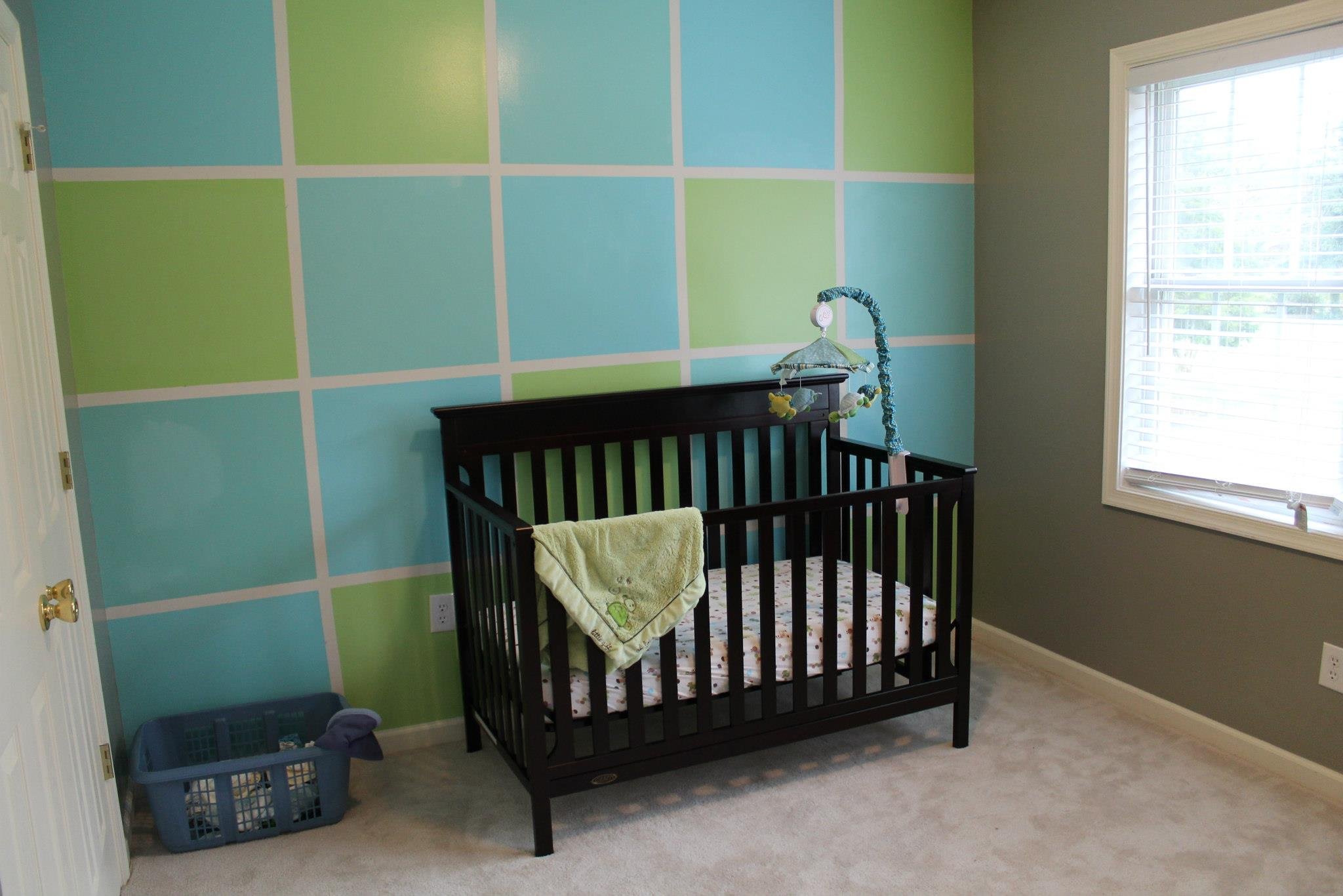 Green and Blue color block nursery with brown crib