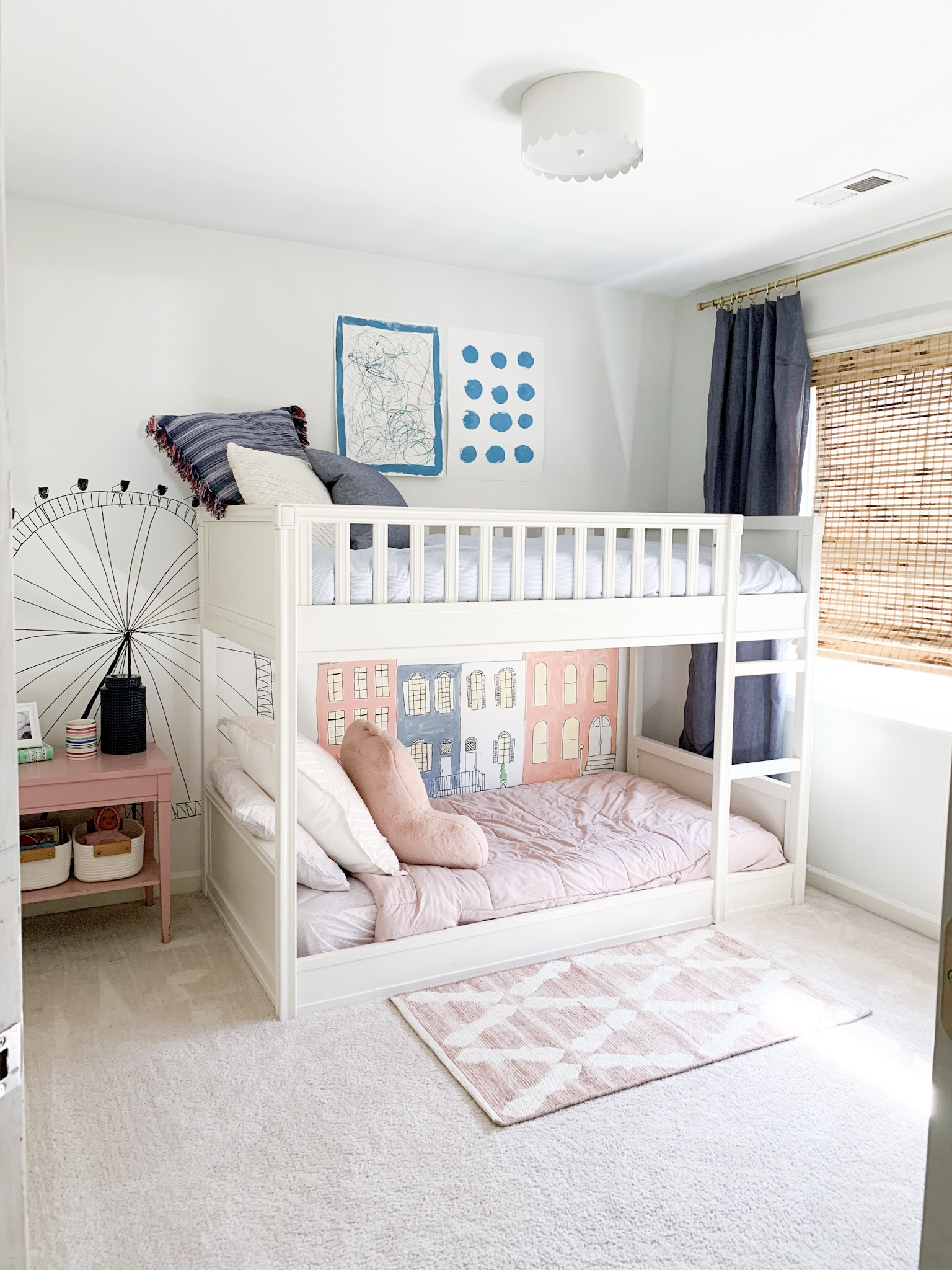 Pink and Blue shared bedroom with Bunk beds, wall mural and Pottery Barn