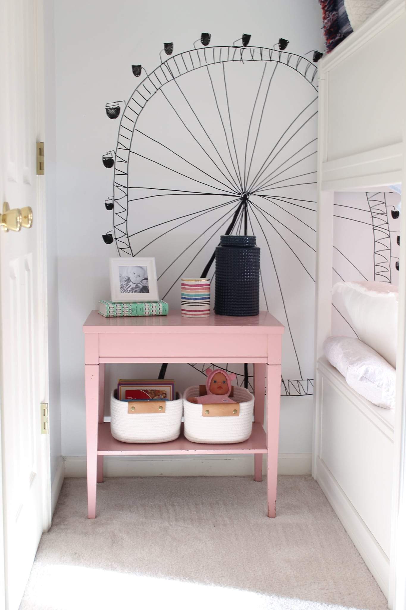 Kid's pink nightstand with storage baskets for toys