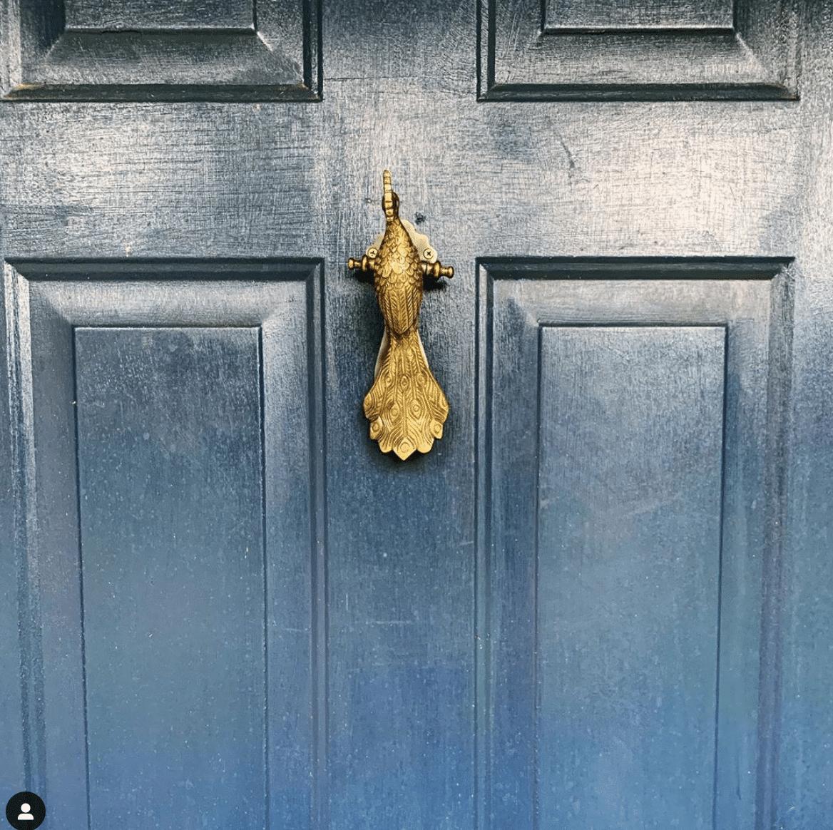 Peacock Door Knocker on Navy Blue front door