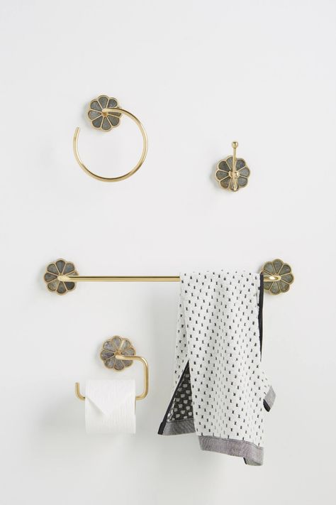 Anthropologie has gorgeous bath towel hooks and towel bars to level up your bathroom decor/
