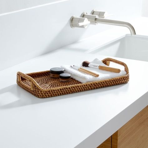 Store guest washcloths on the countertop tray.