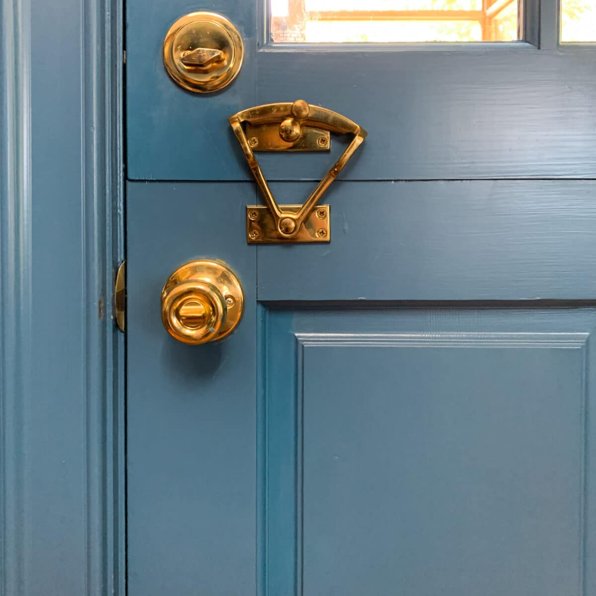 Here is the brass/gold dutch door hardware closed and in the locked position.
