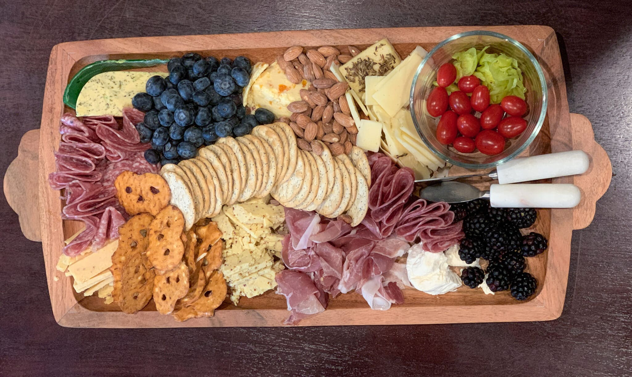How to Make a Cheeseboard for a Fall Dinner Party, example of cheese board with ingredients from Trader Joe's