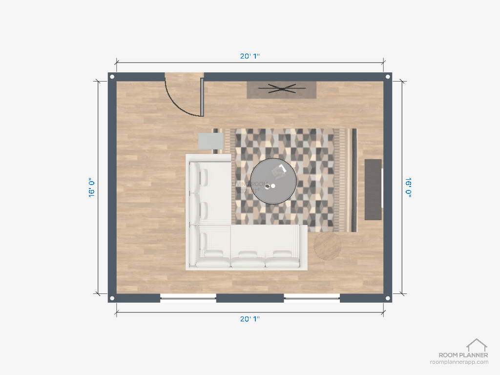 Sectional sofa layout with a round coffee table in the middle.
